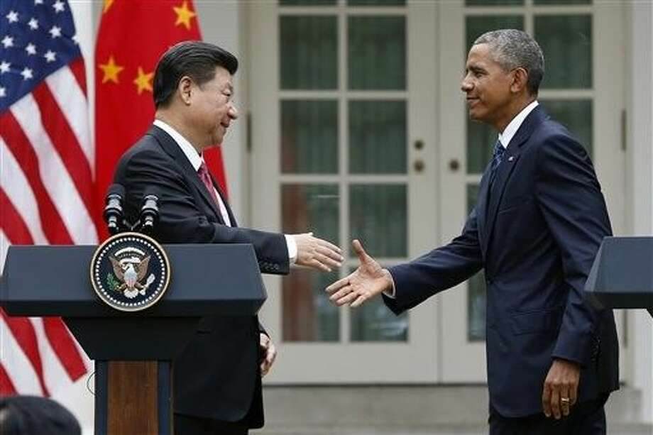 President Barack Obama shakes hands with Chinese President Xi Jinping after their joint new conference in the Rose Garden of the White House in Washington, Friday. Photo: Evan Vucci
