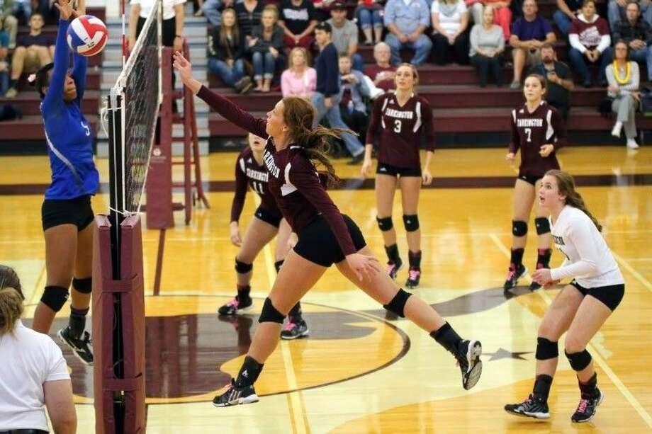 LadyHorns Anna Anderson leaps toward the net on attack against Shepherd, Oct. 14, 2014. Photo: Sean Ashley Jones