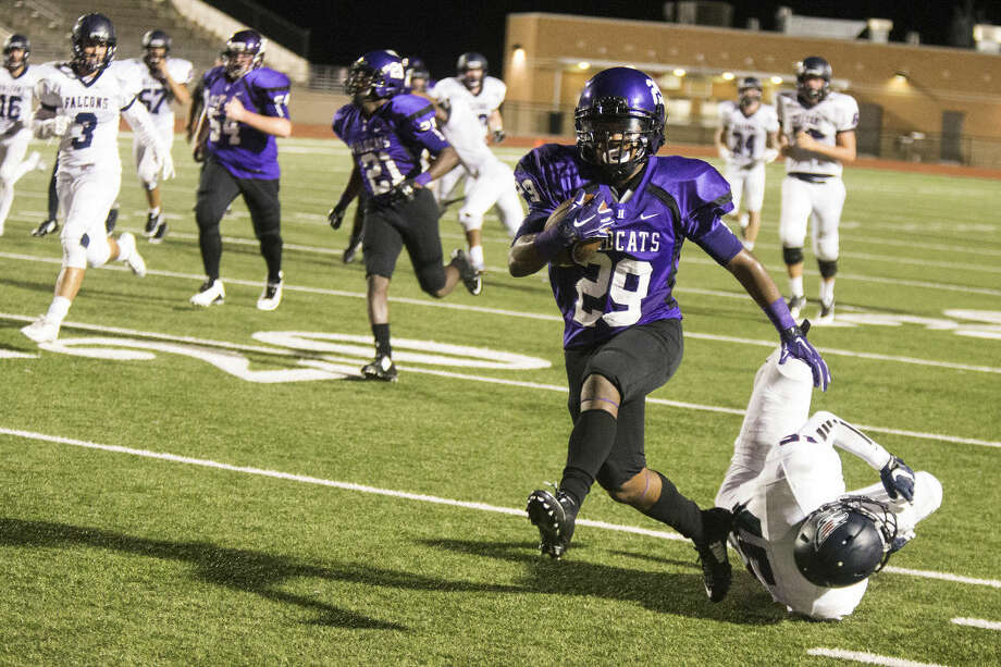 Humble running back Timothy Brown (29) breaks through the defense for a long rush earlier this season. Photo: ANDREW BUCKLEY