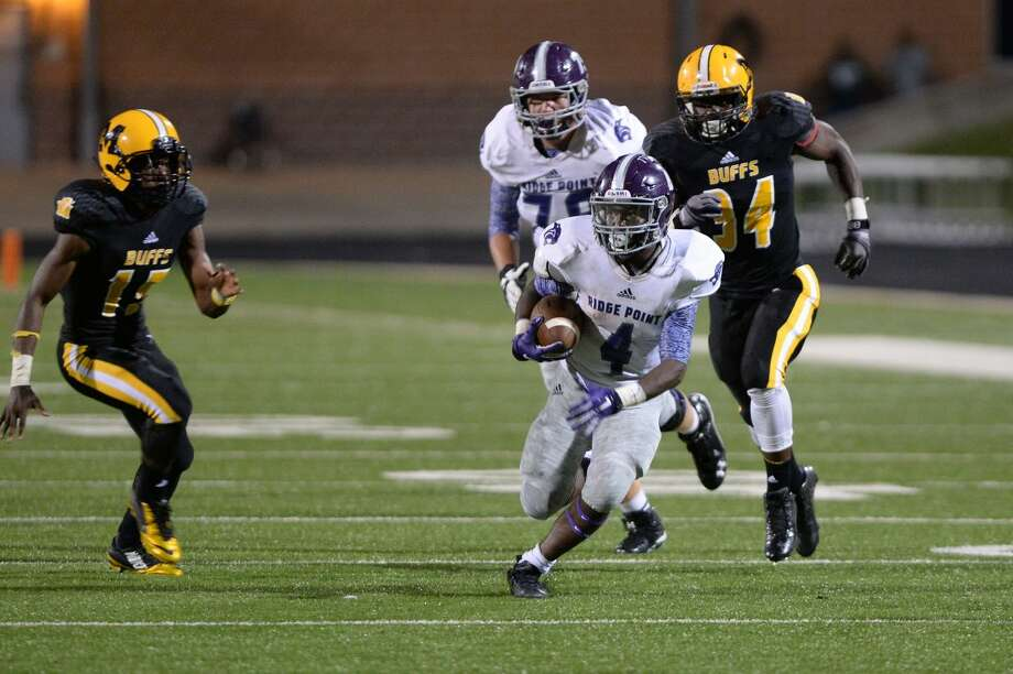 Ridge Point running back B.J. Rainford rushed for more than 200 yards and scored three touchdowns in a 39-6 win against Marshall, Sept. 25 at Hall Stadium. Brandon Brantley (15) defends for the Buffalos. Photo: Craig Moseley