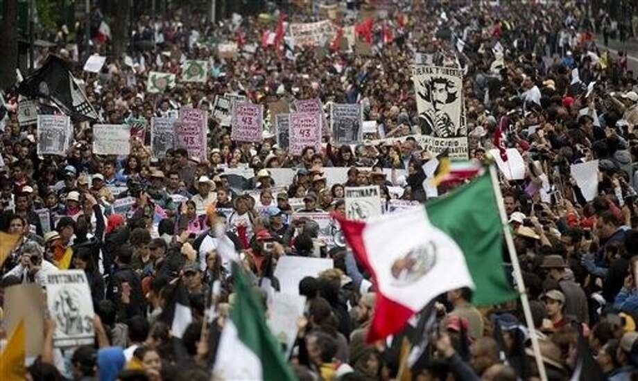 People march along Paseo de la Reforma on the one year anniversary of the disappearance of 43 college students from Guerrero state, in Mexico City, Saturday. Photo: Eduardo Verdugo