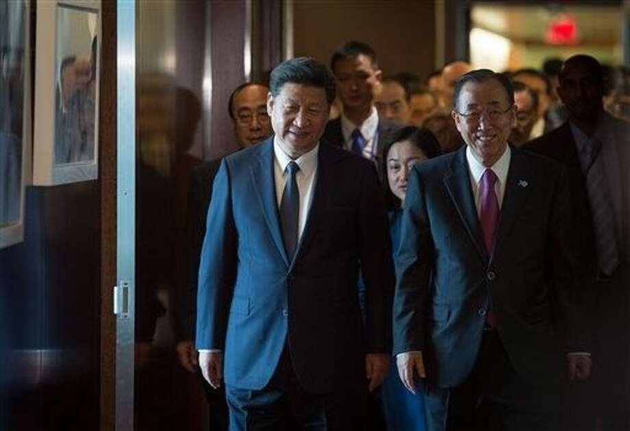 People's Republic of China President Xi Jinping, left walks with with United Nations Secretary-General Ban Ki-moon, right, Saturday at United Nations headquarters. Photo: Bryan R. Smith