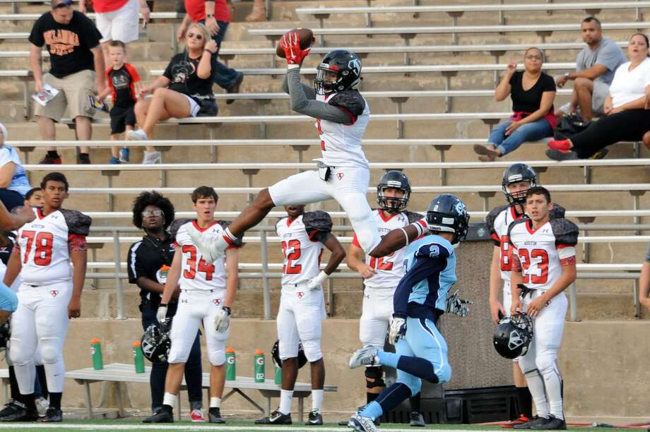 Austin receiver Darius Milton makes a leaping catch against Clements during the Bulldogs' 3-0 victory Sept. 26 at Mercer Stadium in Sugar Land. Austin earned its first win. Photo: Craig Moseley