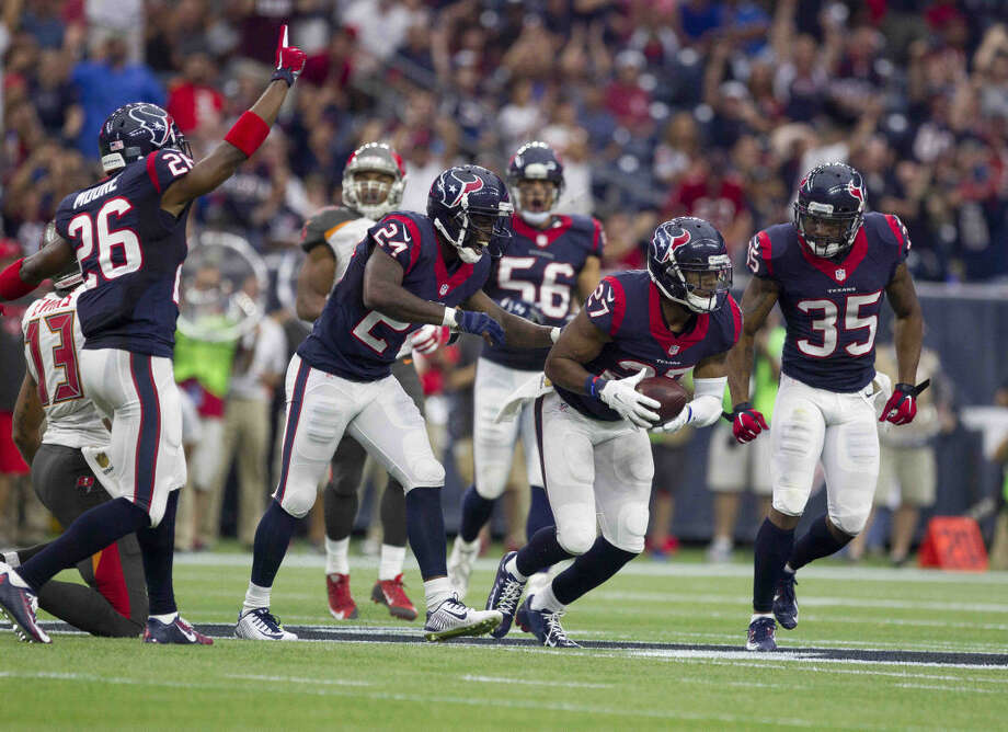 Houston Texans players celebrate after safety Quintin Demps intercepted a pass intended for Tampa Bay Buccaneers wide receiver Mike Evans during the first half of an NFL game Sunday. Photo: Jason Fochtman