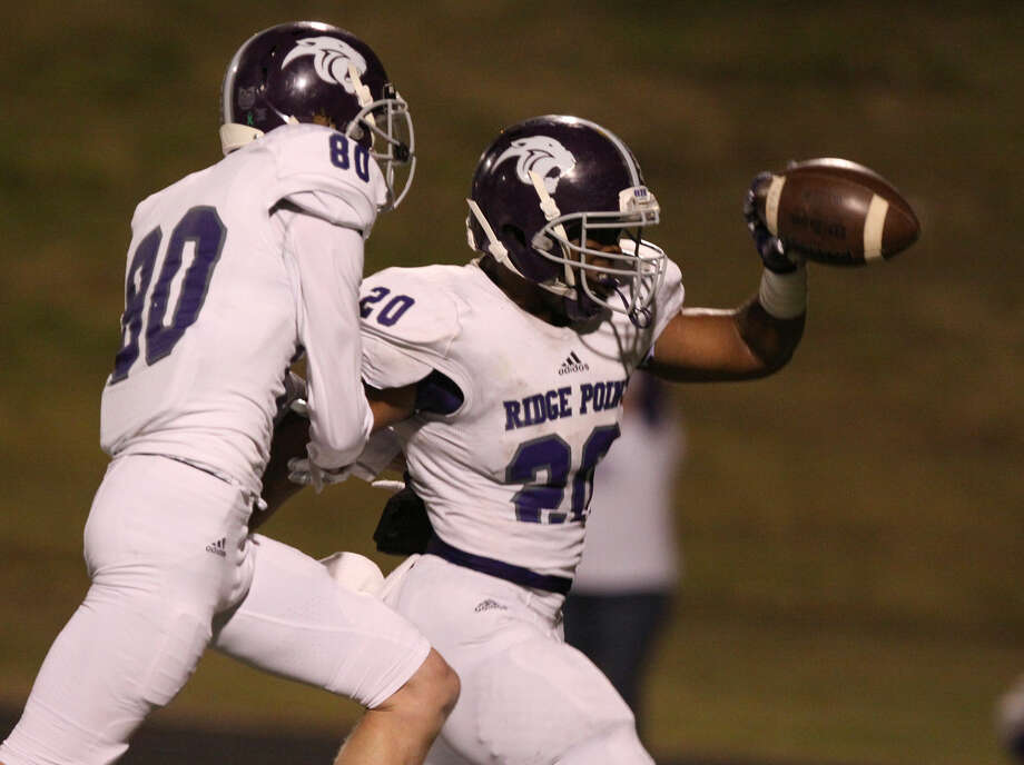 Ridge Point's KeShawn Ledet scores against Elkins during their District 23-5A game Oct. 16 at Hall Stadium in Missouri City. The Panthers won 30-21 to remain undefeated. To view or purchase this photo and others like it, go to HCNPics.com. Photo: Staff Photo By Alan Warren