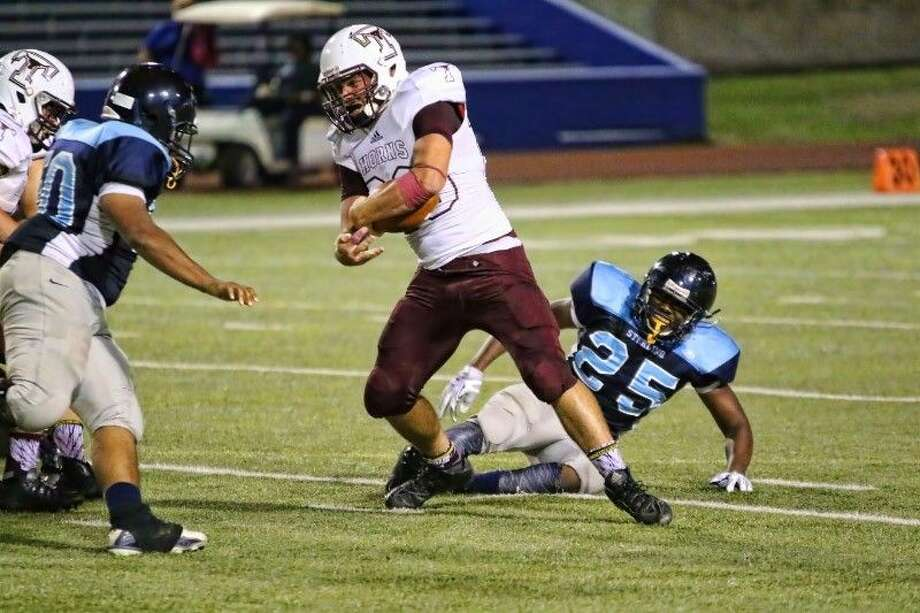 Tarkington's Zach Clifton breaks free of one defender and prepares for more Houston Sterling defenders to try and take him down, Sept. 25, 2015. Photo: Sean Ashley Jones