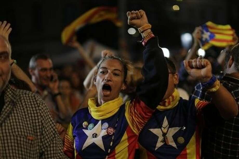 Catalonian independence supporters react in Barcelona, Spain, Sunday. Voters in Catalonia participated in an election Sunday that could propel the northeastern region toward independence from the rest of Spain or quell secessionism for years. Photo: Emilio Morenatti