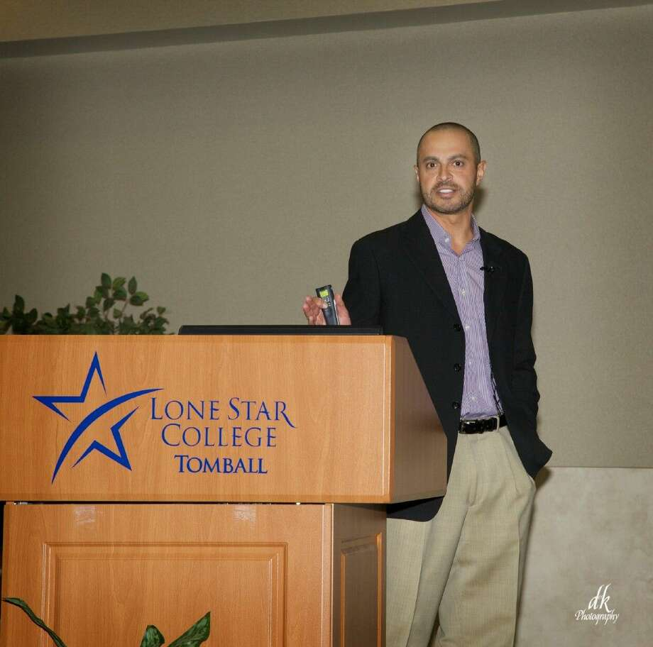 Dr. David Navid speaks about robotic surgery at the GTACC First Friday Luncheon on October 3 at Lone Star College.