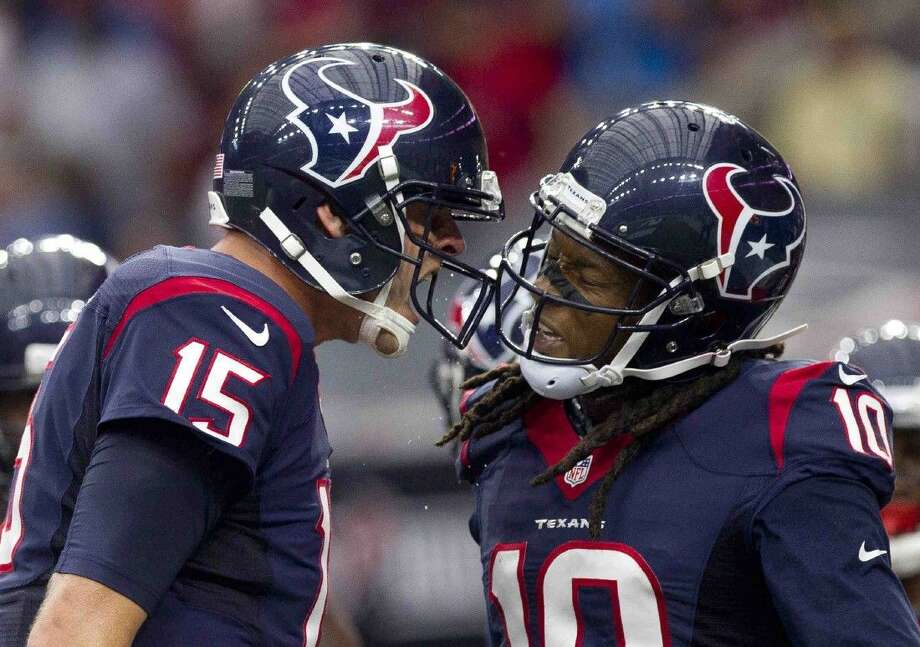 Houston Texans quarterback Ryan Mallett, left, celebrates with wide receiver DeAndre Hopkins after scoring 5-yard touchdown catch in the first quarter of an NFL game Saturday.