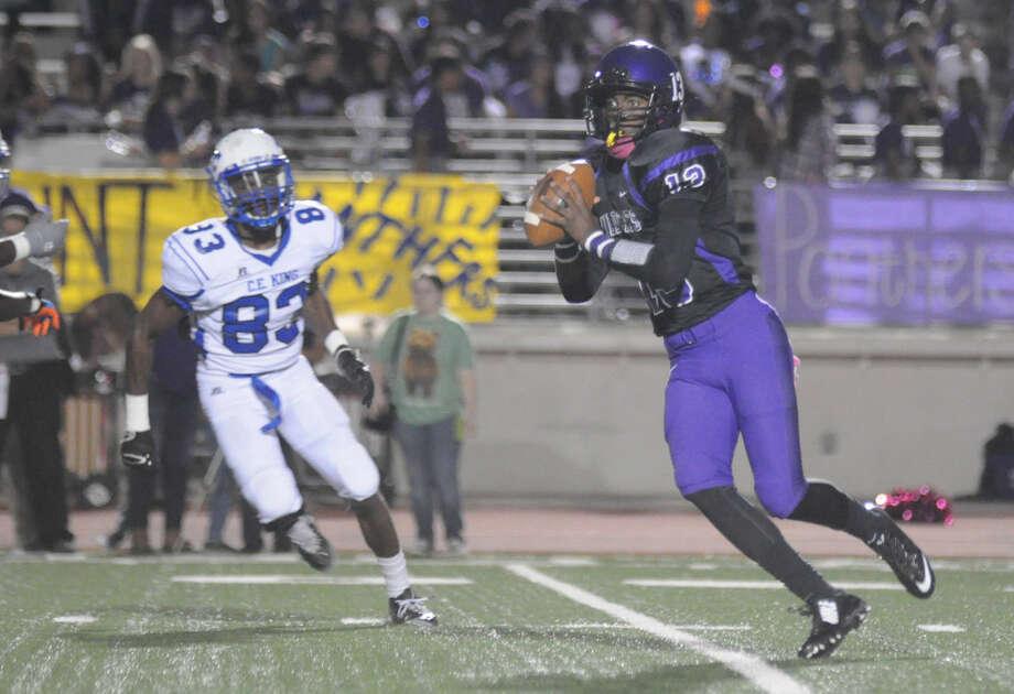Humble quarterback Justin Shepard looks to pass against C.E. King at Turner Stadium on Thursday. Photo: Keith MacPherson