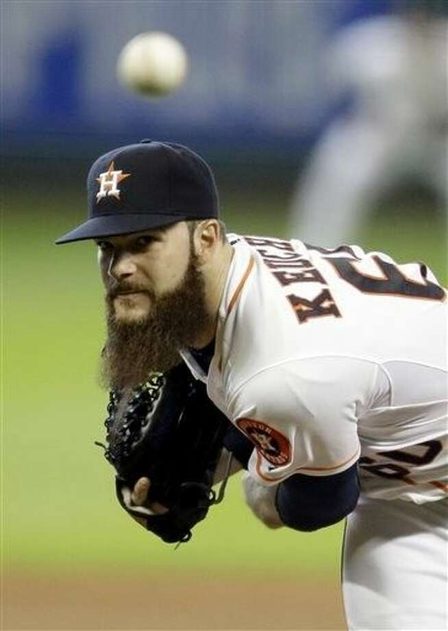 Houston Astros' Dallas Keuchel delivers a pitch against the Texas Rangers in the sixth inning of a baseball game, Sunday in Houston.