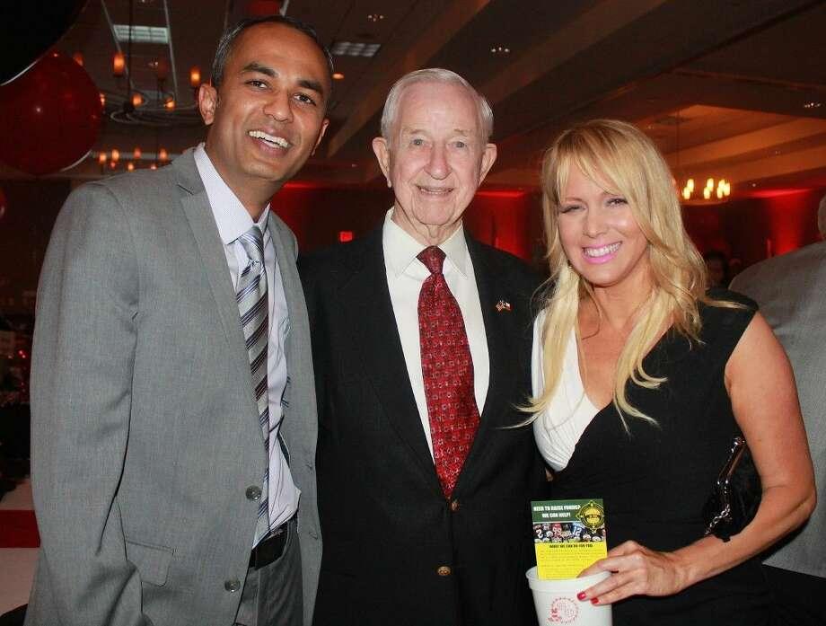 (L-R): Rushi Patel, Mayor Tom Reid, Leisha D'Angelo.