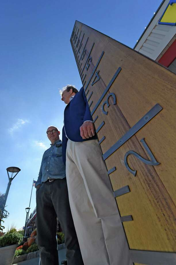 """Artist Peter Kirkiles, left, stands with Edward Swyer, president at the installation of  """"Measure up"""" a new sculpture at Stuyvescent Plaza Wednesday Oct.  5,  2016  in Albany N.Y.   (Skip Dickstein/Times Union) Photo: SKIP DICKSTEIN / 40038274A"""