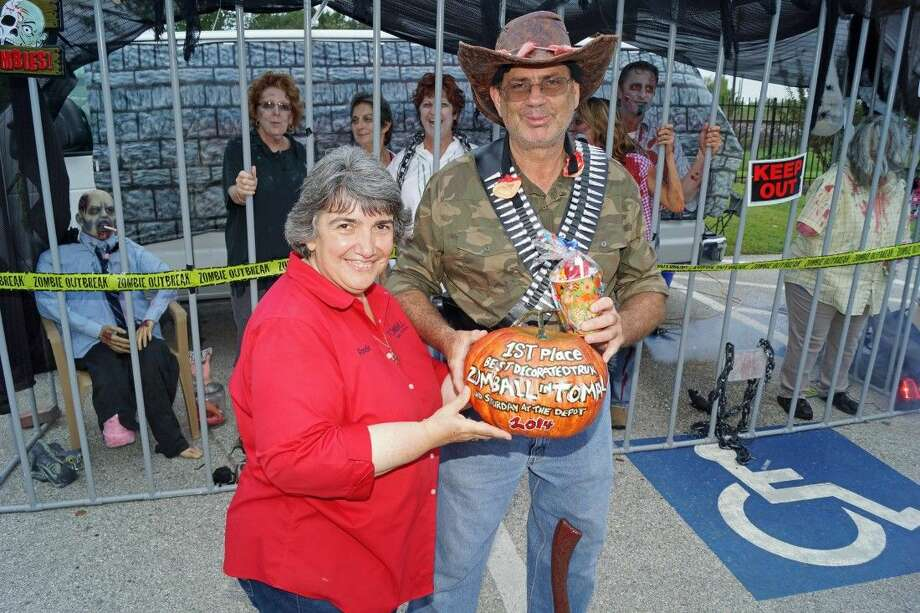 "Wes Burke, winner of the ""Best Decorated Trunk-or-Treat"" during Tomball's third annual ""Zomball in Tomball"" for kids, with City of Tomball's Rosalie Dillon. Photo: Submitted"