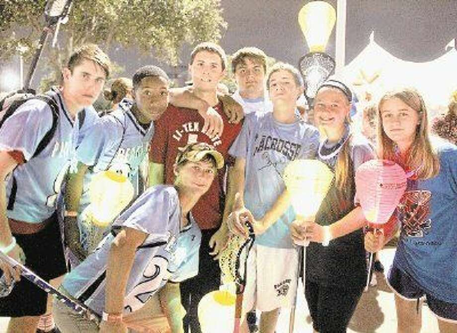 Members of the Pearland Youth Lacrosse League participated in the Light the Night Walk and raised more than $1,500 for the Leukemia and Lymphoma Society Saturday (Oct. 11). Photo: Kristi Nix/The Journal