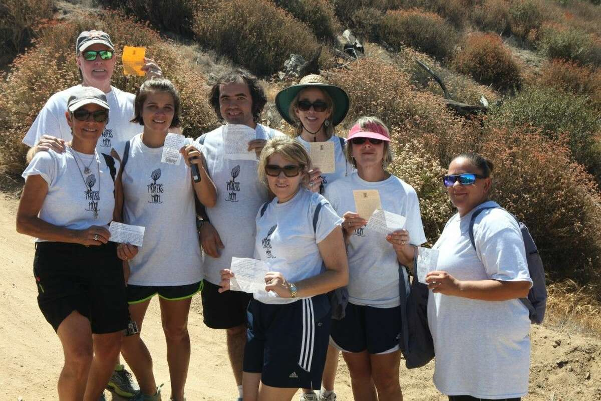 Sherry Lewis (left), Tad Lewis, Paige Lewis, Adrian Bourgeois, Jennifer Mabray, Jan Jarke, Paulette Nemec, and Christian Arrambide on their hike to the survival tree.