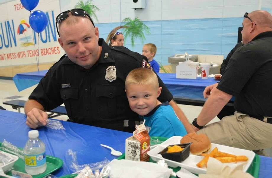 Deer Park Elementary invited police officers to eat lunch at the school on Friday, Sept. 18. Pictured is Pasadena Police Officer Nicholas Hurst eating lunch with his son, Gunner. Photo by Jeri M. Martinez/DPISD Communications