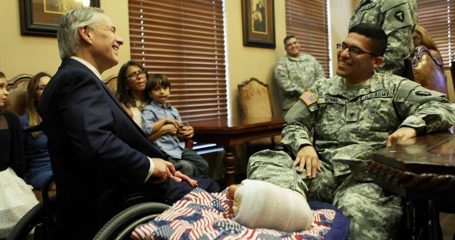Governor Greg Abbott on Thursday in Austin presented the Texas Purple Heart to U.S. Army Private First Class Jose Romo of Pasadena.