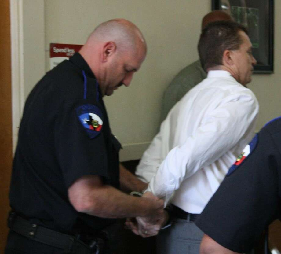 Terry Holcomb Sr. is arrested on Tuesday during a San Jacinto County Commissioners Court meeting. He is accused of disrupting a public meeting. Photo: Jacob McAdams