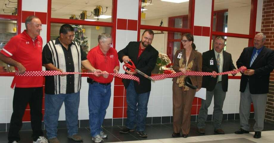 Splendora ISD school board members conduct a ribbon-cutting ceremony on Oct. 13 to kick off a tour of the new campus facilities, which marks the completion of the 2012 voter approved bond construction project. Photo: Staff Photo By Stephanie Buckner
