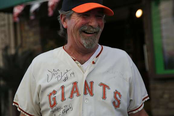 Michael McMahon of San Francisco chats with the Chronicle about his hopes that the Giants might win while wearing a jersey that belonged to his father's cousin who was a pitcher and a pitching coach over 30 years ago as McMahon stands outside of the Giants Dugout merchandise store Oct. 5, 2016 in San Francisco, Calif.