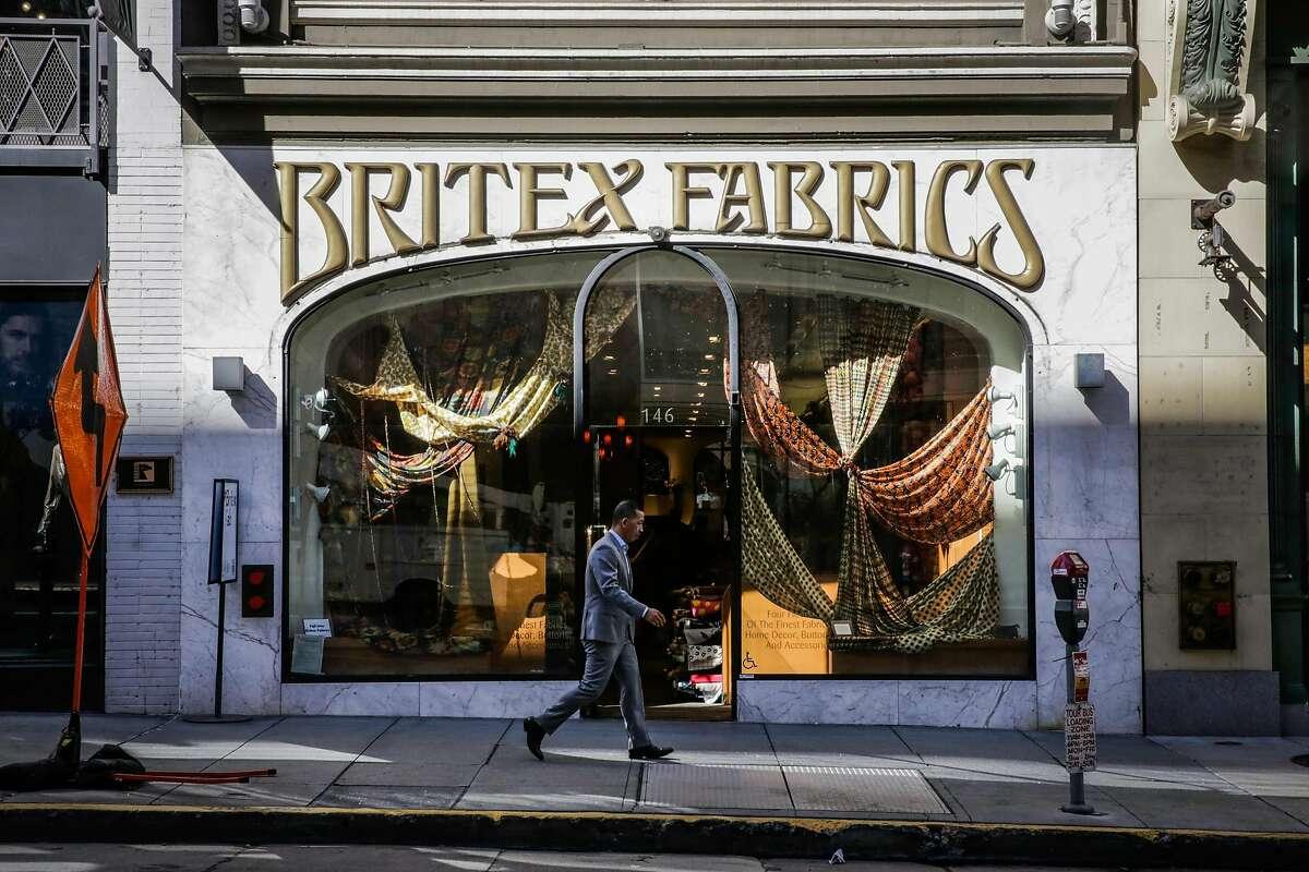 A man walks past Britex Fabrics on Geary Street, in San Francisco, California, on Wednesday, Oct. 5, 2016.