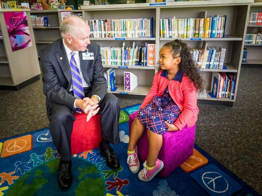 Superintendent Dr. Jim Cain of Klein ISD welcomes the district's 50,000th student Vivian Taylor from Mueller Elementary School. Photo: Justin Elbert