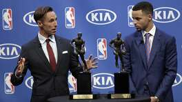 Steve Nash, left, gestures beside Golden State Warriors guard Stephen Curry during the NBA's Most Valuable Player award presentation Tuesday, May 10, 2016, in Oakland, Calif. Curry is the first unanimous NBA MVP, earning the award for the second straight season. (AP Photo/Ben Margot)