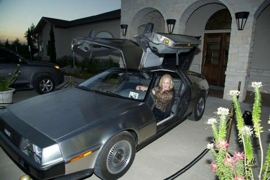 Donna Shipwash of Network Texas pictured in the DeLorean from Back to the Future. The car will be available for photographs at Parties with Purpose on Oct. 21 at Reno's Wine Cellar in Tomball. Photo: Submitted