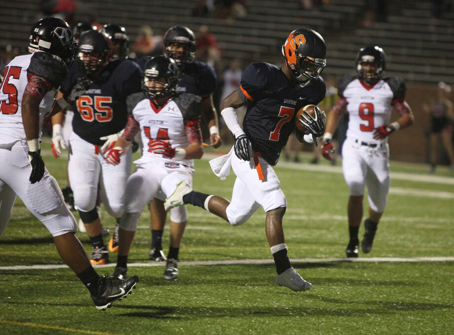 Seven Lakes' Braeden West scores a touchdown against Austin during a non-district game Sept. 5 at Rhodes Stadium in Katy. West had five touchdowns in a 77-33 victory against Strake Jesuit. Photo: Staff Photo By Alan Warren