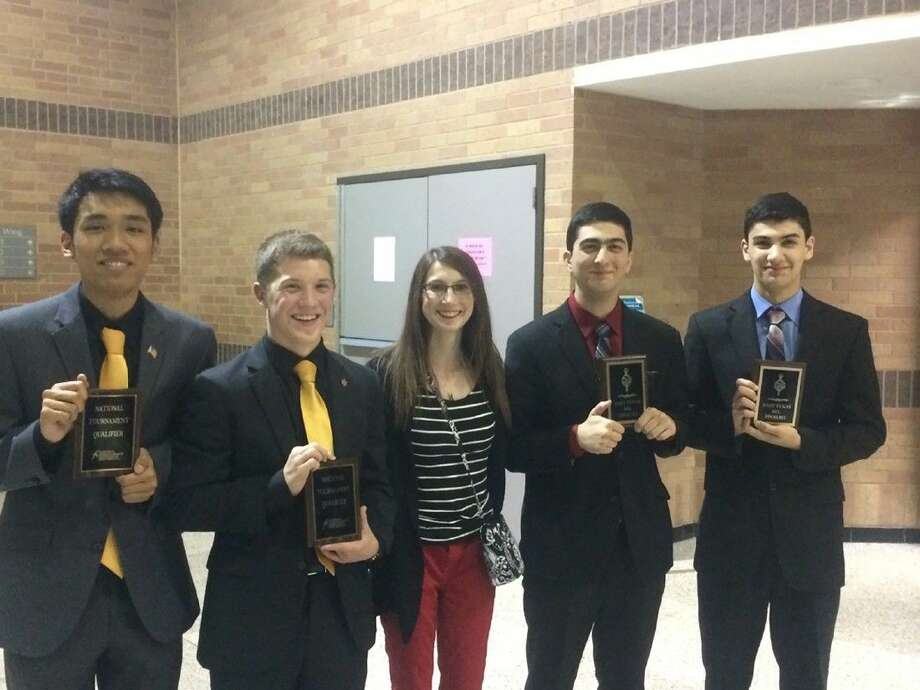 Jersey Village High School speech and debate coach Regina Jennings, center, won her first Diamond Award for excellence in coaching this month. She is pictured with (L-R) NSDA National Championship qualifiers Justin Meun, Noah Kopesky, Mustafa and Ahmed Al Nomani last spring.