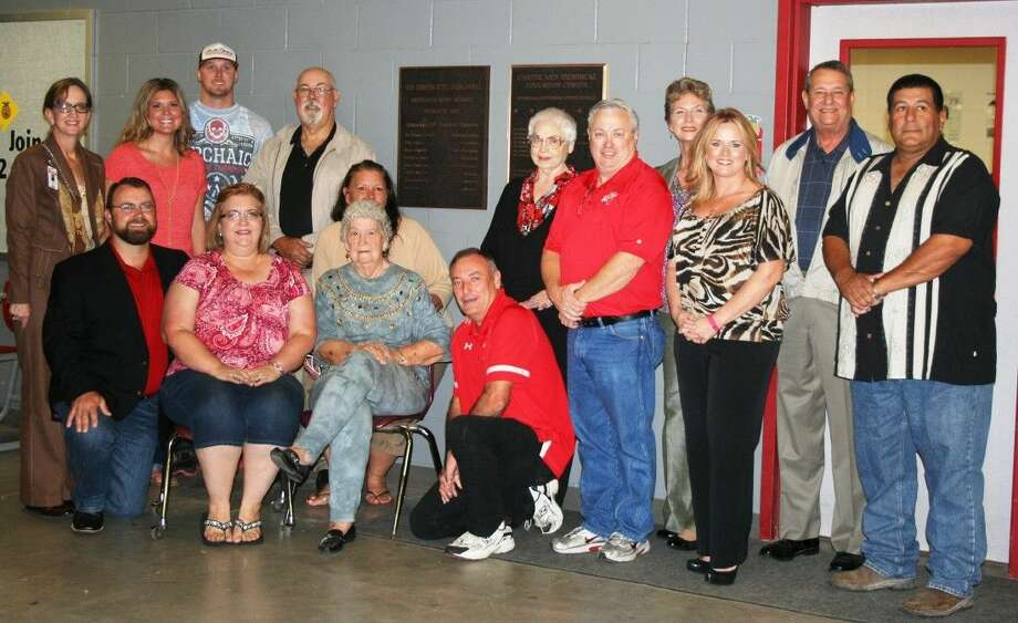 On Oct. 13, Splendora ISD administrators and staff members gathered alongside the family of former longtime board member Edward Smith, who passed away on 2010, to commemorate the renaming of the CTE building to include his namesake. Photo: Stephanie Buckner