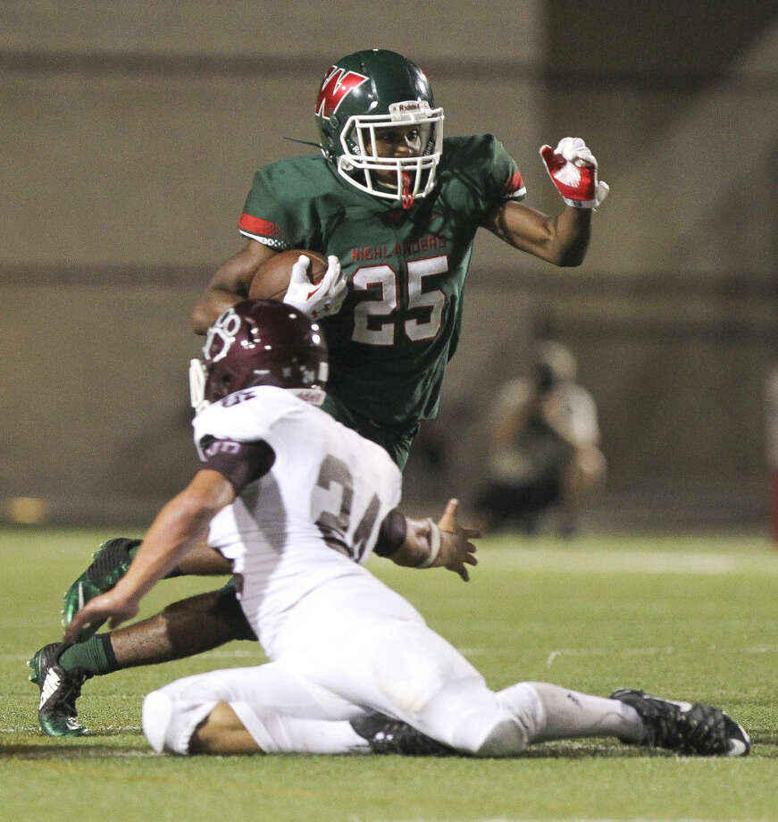 The Woodlands running back Jordan Talford gets past a Cy-Fair defender during a high school football game. To view or purchase this photo and others like it, visit HCNpics.com.