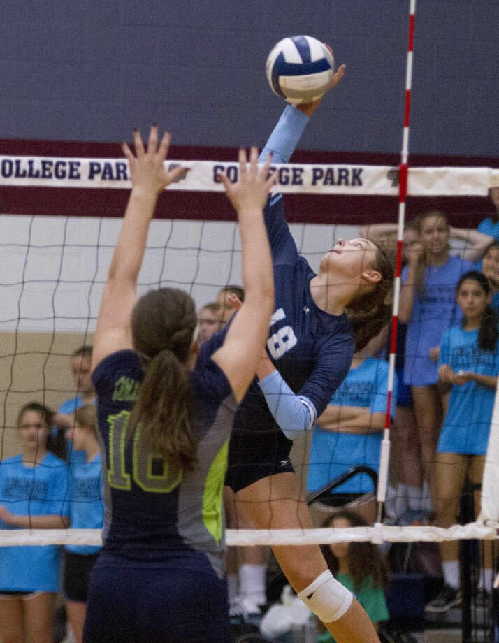 Kingwood's Effie Zielinski goes up for a shot against College Park's Hannah Erwin during a volleyball game Tuesday. College Park defeated Kingwood in striaght sets. To view or purchase this photo and others like it, visit HCNpics.com.