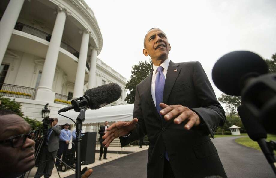 President Barack Obama stops to make a statement to members of the media on the South Lawn of the White House, Tuesday following a short trip from Andrews Air Force Base.