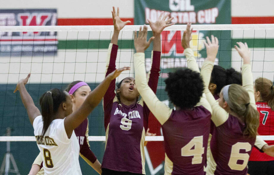 Summer Creek celebrates a point during a volleyball game Tuesday. The Woodlands defeated Summer Creek in striaght sets. To view or purchase this photo and others like it, visit HCNpics.com. Photo: Jason Fochtman