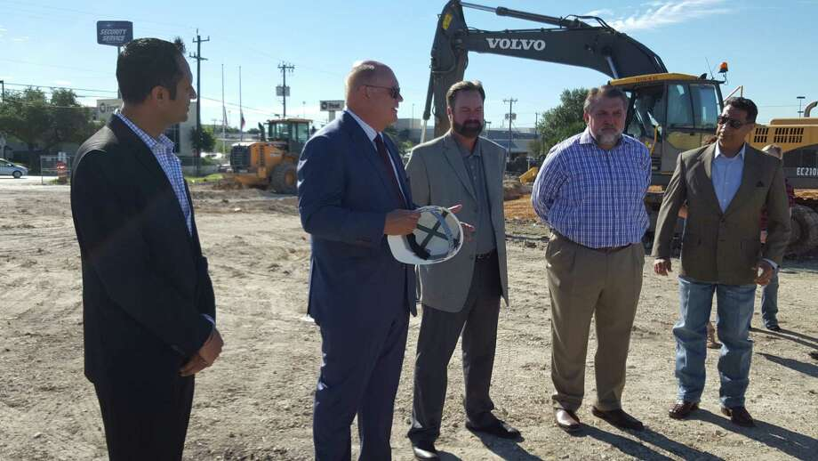Windcrest Economic Development Corp. President Tim Maloney (second from left) offers words at the site of the new Holiday Inn Express. Photo: By Jeff B. Flinn /Northeast Herald
