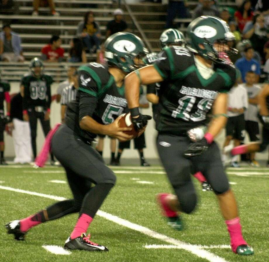 Eagles quarterback Valor Ojeda and Marwin Pereira, starting a first-half play, were instrumental in overcoming a 27-7 halftime deficit Friday night. Pereira scored three second-half TDs and Ojeda one. Photo: Robert Avery