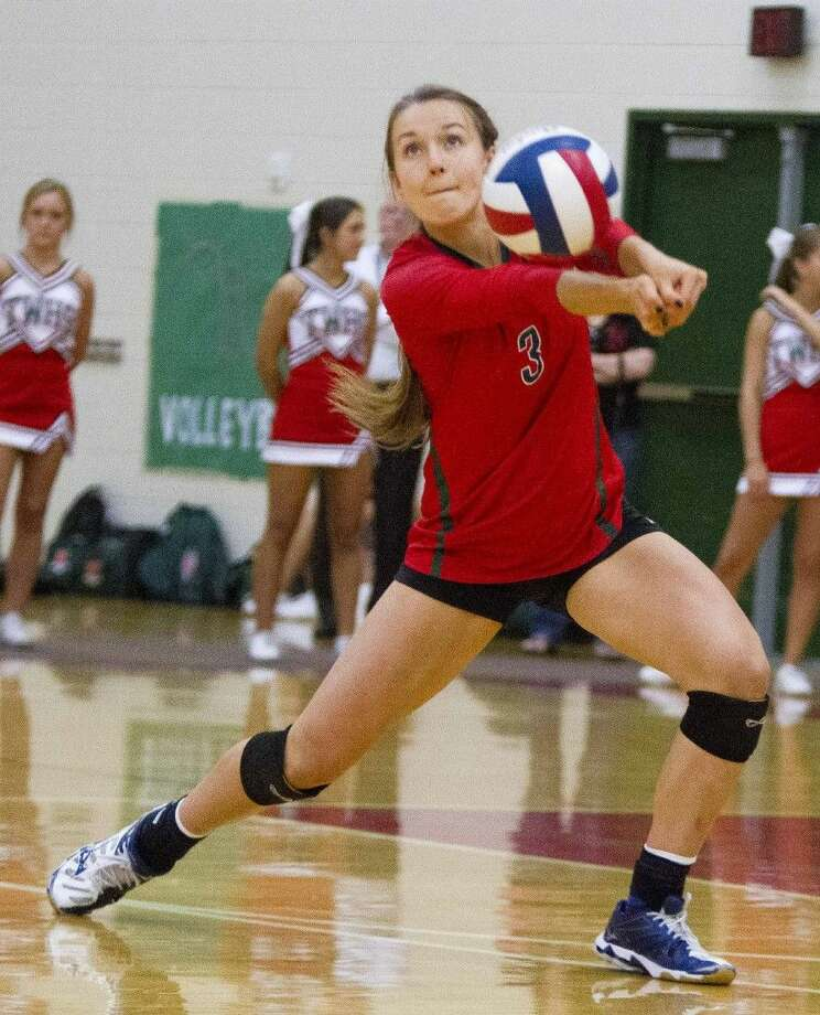 The Woodlands' Hailey Reier returns a serve during a volleyball game Tuesday. The Woodlands defeated Summer Creek in striaght sets. To view or purchase this photo and others like it, visit HCNpics.com.