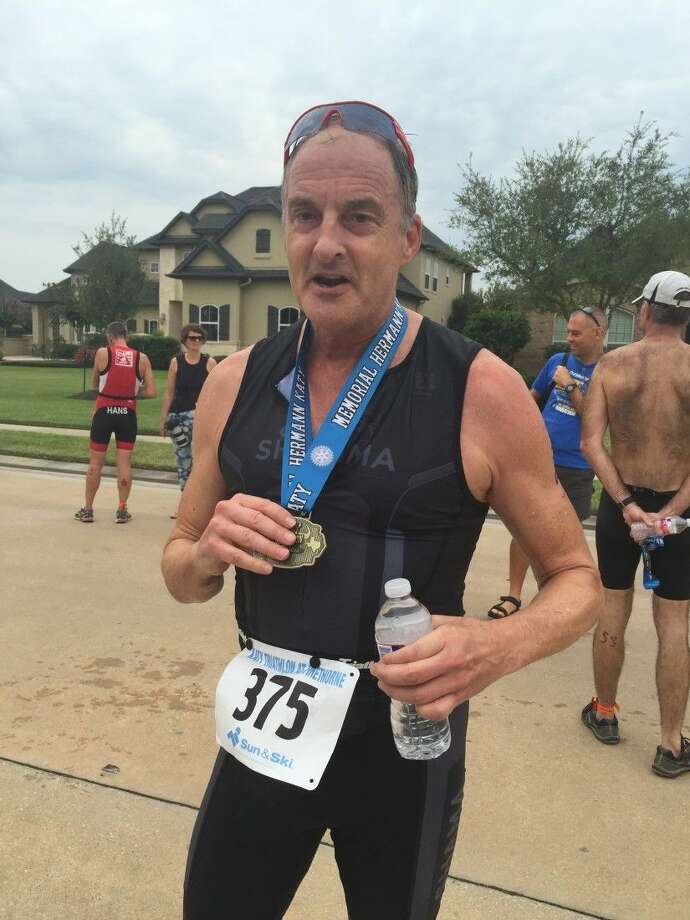 Jeff Gill receives his 2015 Katy Triathlon medal that he completed the race. He was given the number 375 to commemorate his achievement, and finished second in his age group.