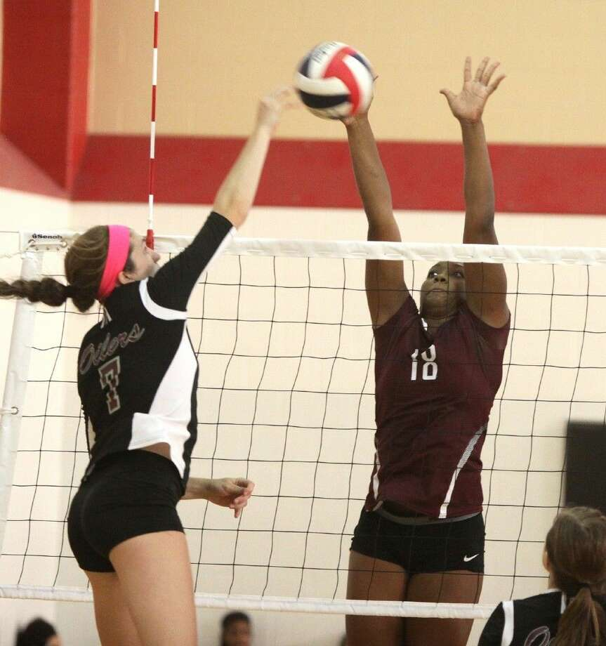 Cinco Ranch's Makayla Randle blocks Pearland's Brooke Botkin during the Spring Branch ISD 2014 Varsity Tournament, Aug. 21 at Memorial High School in Houston. Photo: Alan Warren