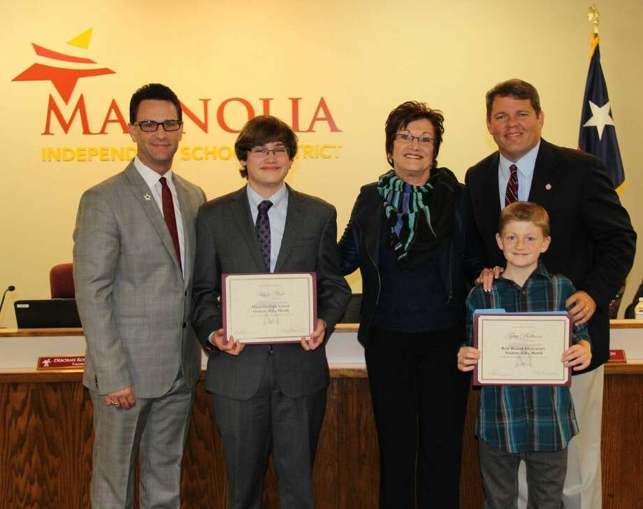 School Board President Deborah Rose Miller along with Principals Jeff Springer and Foy Campbell honor their students William Blake from Magnolia High School and Tyler Buttram from Bear Branch Elementary for MISD Student of the Month.