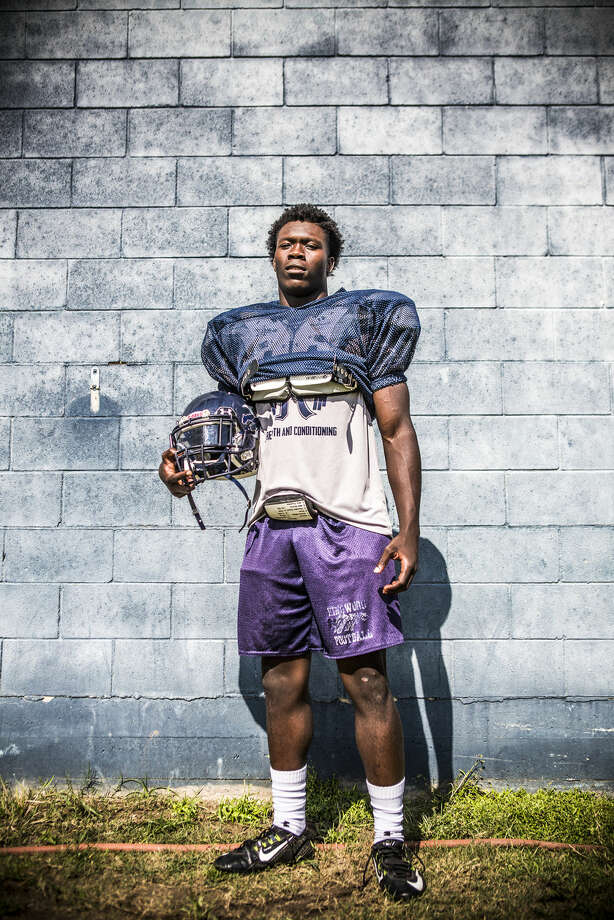 Mustangs running back Sewo Olonilua poses for a portrait Sep. 29, 2015, at Kingwood High School. Photo: ANDREW BUCKLEY