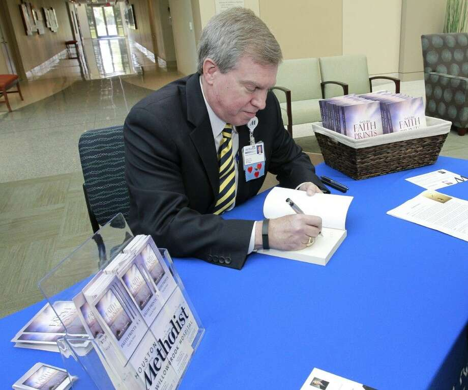 "Dr. Mark Young, director of spiritual care and values integration at Houston Methodist Willowbrook Hospital, signed more than 100 copies of his new book, ""Faith Prints: God Is Here,"" at a recent book signing event. Photo: Submitted Photo"