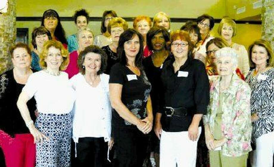 New members pose for a photo at the September luncheon.