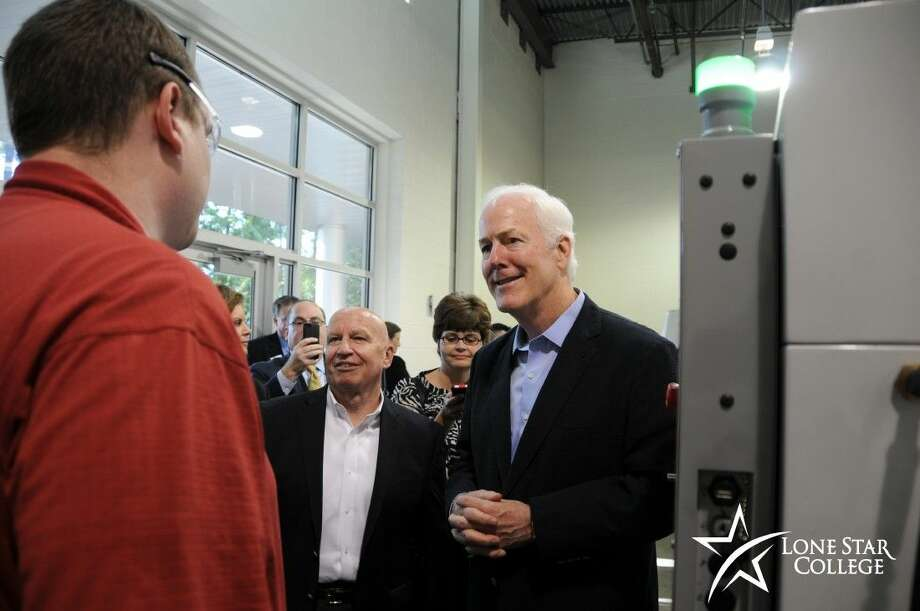 U.S. Sen. John Cornyn, right and U.S. Rep. Kevin Brady, center, visit with an instructor at Lone Star College-Conroe Center to learn more about how LSC is helping to fill the middle skills job gap. Photo: Submitted