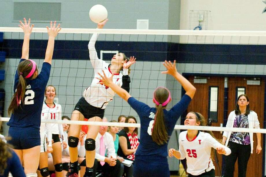 Tomball's Marie Pierce goes up for a kill against Tomball Memorial on Tuesday, October 14, in a four-set win for the Lady Cougars.