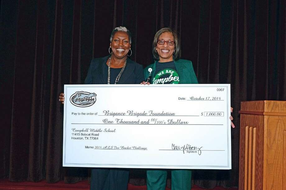 Campbell Middle School principal Dr. Cheryl Henry, right, presents a $1,000 check on behalf of Campbell to Barbara Brigance of the Brigance Brigade on Oct. 17 during lunch period. The Brigance Brigade's mission is to equip, encourage and empower people living with ALS. Photo: Submitted Photo