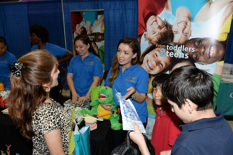 Representatives from Say Ahhh! Pediatric Dentistry interact with visitors at the inaugural CFISD Health Expo on Oct. 11 at the Berry Center. More than 2,800 guests attended the community-wide event. Photo: Submitted Photo