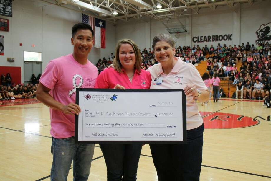 Steve Tran, Clear Brook High School athletic trainer; Katy Cucco, Dickinson High School athletic trainer; and Cathy Supak, Houston Methodist & Clear Brook High School athletic trainer are shown with a ceremonial check for M.D. Anderson Hospital in the amount of 1,025. Photo: SUBMITTED PHOTO